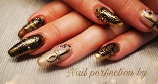 Egyptian design nails with a bit of glitter and lots of gold