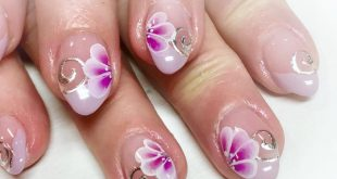 Spring nails in a delicate lilac with silver foil accents and one-stroke flower