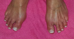 White French modellage on the toenails