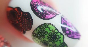 Maceo close up of todays sugar skull mani using  stamping polishes from the disc